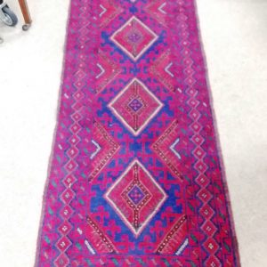 Handmade_ wool_ rug _red_ and_ blue