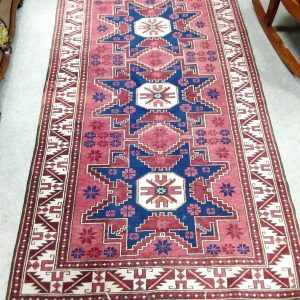 Handmade_ wool_ rug_ red_ and_ navy