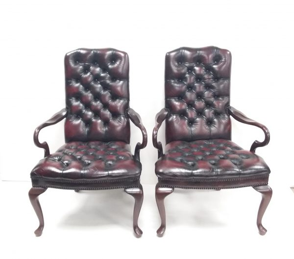 pair of button back leather armchairs